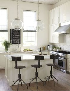 Having a white kitchen makes me so nervous. But it's so pretty!  // #kitchen #home #white