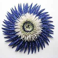 """Shards Flower Collection. Zemer Peled """"Zemer Peleds work examines the beauty and brutality of the natural world. Her sculptural language is formed by her surrounding landscapes and nature engaging with themes of nature and memories identity and place. Her works are formed of thousand of ceramic shards constructed into large-scale/small-scale sculptures and installations."""""""