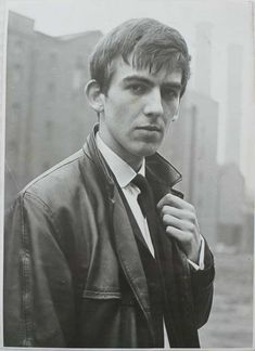 George Harrison from The Beatles first photo session with Ringo Starr at Liverpool's Docklands, 1962. Photo by Peter Kaye.
