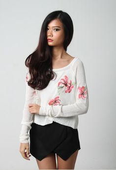 A lovely pullover with pretty floral embellishments. Delightful chic casual design that is comfortable for our local weather.   Made of soft lightweight and slightly sheer knit material. Inner singlet worn by model is not included. Available in 2 colours at www.LaceAndButtons.com!