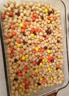 Peanut butter cereal treats...yum!!! Melt 4 tbsp butter and 10 oz bag mini marshmallows on low heat, add a large dollop of peanut butter, mix well. Pour over 7 cups of captain crunch peanut butter cereal, mix well. Mix 2 oz of Reese pieces in. Spray 9x13 pan with Pam and press mixture in.  Sprinkle 2 oz Reese pieces on too and press in lightly. Allow to cool on counter and cut into squares.
