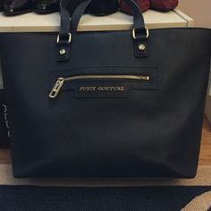 juicy couture navy tote big bag, perfect to use as either-- diaper bag, school bag, everyday bag, or light travel bag. fairly new, worn a few times, still have tag. Juicy Couture Bags Totes