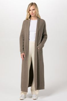 100% Mongolian Cashmere | Locally made in Mongolia Plain knit Shawl collar long cashmere cardigan Relaxed fit Open front Patch pockets Ribbed cuffs and hem Soft and lightweight Model is wearing size S | height 173cm | chest 86cm | waist 59cm | hips 86cm| CASHMERE CARE Dry cleaning is recommended. Consult care label on Cashmere Cardigan, Long Cardigan, Ideal Fit, Knitted Shawls, Your Best Friend, Taupe, Duster Coat, Mongolia, Dry Cleaning