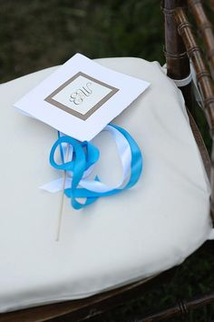 Programs and wedding wands by New England Invitations.