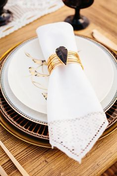 Bohemian bracelet napkin ring | Photo by Jodee Debes Photography | Read more - http://www.100layercake.com/blog/wp-content/uploads/2015/04/Desert-Coachella-wedding-inspiration