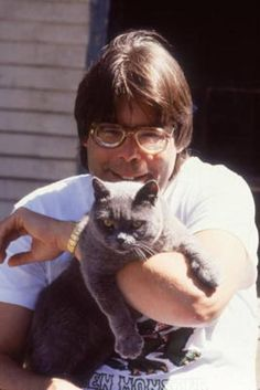 "Horror author Stephen King with his fierce-looking British Shorthair (possibly the cat from his ""Pet Sematary"" movie)."