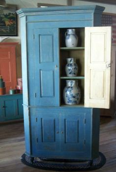 A FEDERAL BLUE AND RED-PAINTED CORNER CUPBOARD Probably New Jersey ...