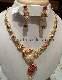 Jewellery Designs: Fancy Mango Set with Peacock Locket