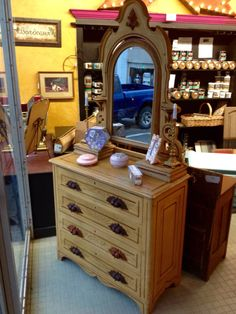 Gorgeous antique dresser has jewelry boxes and candle stands.  Paint or no?