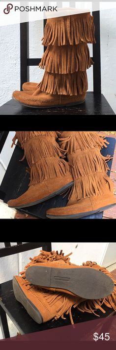 Minnetonka 3 Layer Fringe Moccasin Boots Please look at the picks closely. I was able to find 2 spots as shown in last 2 pics. Otherwise in great condition. Size 8. Open to offers... ships promptly! Minnetonka Shoes