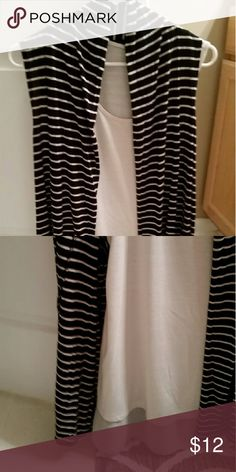Blouse and Vest Set Tank top blouse and tank vest. Goes great together. Can be sold seperately. Excellent condition. The blouse is missing the tag. Tops Blouses