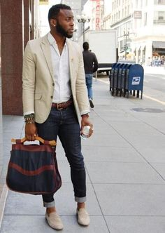 Make a nude blazer jacket and black jeans your outfit choice for drinks after work. Finish off this look with grey suede loafers.  Shop this look for $249:  http://lookastic.com/men/looks/longsleeve-shirt-blazer-belt-jeans-tote-bag-loafers/6457  — White Polka Dot Longsleeve Shirt  — Beige Blazer  — Dark Brown Leather Belt  — Black Jeans  — Black Canvas Tote  — Grey Suede Loafers