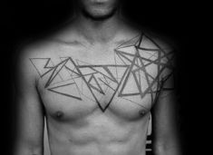 Geometric style black and white chest tattoo of various figures