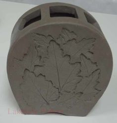 slab vase with leaves impression project http://www.lakesidepottery.com/Pages/Pictures/Handbuilding-projects-ideas-pictures.html