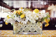 Heart fluttering for this zesty twist of a centerpiece with lemons and white and yellow florals!