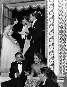 Party at Arturo Lopez Home, Neuilly, June 1952 by Robert Doisneau
