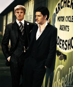 Bradley James and Colin Morgan in suits.  Can we say gorgeous?  (Yes, but only after we wipe the drool off our chin!)