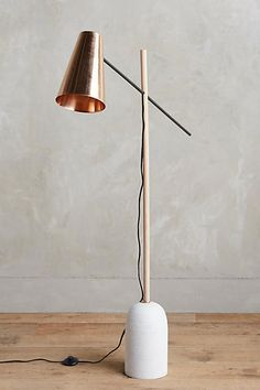 Slanted Copper Floor Lamp - anthropologie.comThis stunning piece is crafted of the unexpected combinations of copper and marble, angles and curves. Its pivoting shade and sleek modern design make it an inspired choice for an office or favored reading room. Handmade. Copper, white oak, iron and marble.