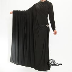 "Abaya - ""cloak"" ometimes also called an aba, is a simple, loose over-garment, essentially a robe-like dress, worn by some women in parts of the Muslim world including in North Africa and the Arabian PeninsulaThe abaya covers the whole body except the face, feet, and hands. It can be worn with the niqāb, a face veil covering all but the eyes. Some women choose to wear long black gloves, so their hands are covered as well."