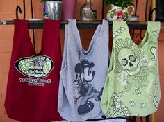 Repurpose old t-shirts by turning them into hand bags.