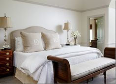 tan upholstered headboard, monogram pillows.  Again, utter simplicity.  Would probably like a Hudson Valley artwork or a simple starburst mirror.