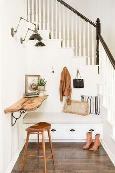 Scandinavian style entrway with natural wood and built in bench