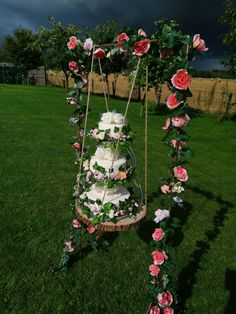 Rose-gold wedding cake swing with a wooden slice to hold the 3 tier wedding cake stand and it's faux wedding cakes with their flower decorations.  A brilliant alternative to buying an expensive wedding cake. Have stunning wedding cake-cutting pictures without the expense. Available to hire from www.limelightweddings.co.uk 3 Tier Wedding Cakes, Wedding Cake Stands, Flower Decorations, Wedding Decorations, Table Decorations, Wedding Hire, Gold Wedding, Manzanita Tree Centerpieces, Wedding Cake Cutting