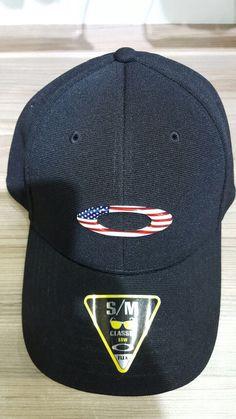 Boné Oakley tincan preto com símbolo com a bandeira americana 85eb020f907