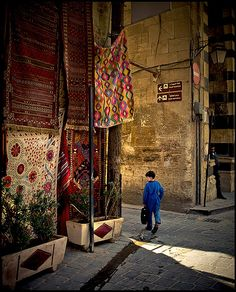 Aleppo street. In LOVE with those rugs!