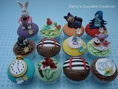 A selection of dome and buttercream swirl chocolate cupcakes decorated in an Alice in Wonderland theme