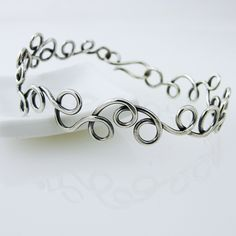 Gorgeous, easy to wear summer bracelet! Doodle Swirls! awejewelry.com