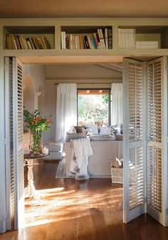 Shutters and bookshelf above door.