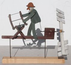 Antique wooden carved whirligig featuring a bearded gentleman sawing wood