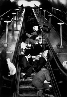 People asleep on the escalators at Piccadilly Tube Station, London, during an air raid, 1940.