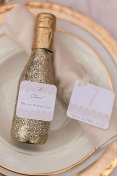 Fabulous glittery gold bottles of champagne for the guests