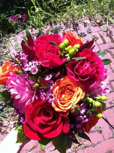 Bright and colorful bridal bouquet created by Lexington Floral in Shoreview, Minnesota.    #wedding #weddingflowers