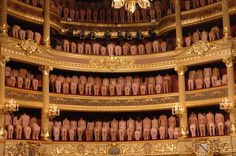 Volunteer participants pose naked inside the Stadschouwburg theatre during a photo session with U.S. photographer Spencer Tunick in the northern Belgian city of Bruges on May 7, 2005.