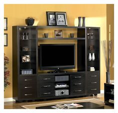 Brockton Wall Unit. EC2050WA104-E451. Espresso (E451) finish. RTA Construction. Touch me with 4 settings pier lights. Soft close concealed Euro hinges. Sold as a single media console or complete media wall system