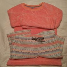2 PC fleece pjs 2 PC fleece pj set. Long sleeve coral top and pattern elastic drawstring waist pants. Worn and washed once. A few pills from washing otherwise perfect! SO Intimates & Sleepwear Pajamas
