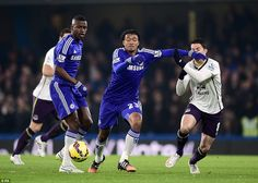 Cuadrado steals the ball from team-mate Ramires and surges forward past Everton's Oviedo (right) to prompt another Chelsea attack