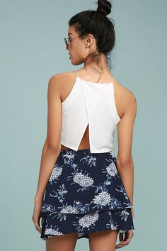 You won't want to take off the Won't Let Go Navy Blue Floral Print Mini Skirt! Navy blue and white floral print, textured woven poly flows from a high waist (with elastic at back) into a tiered skater skirt with decorative button placket at front.