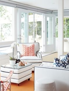 white room. Love the trim on the chairs, ottoman, and couch