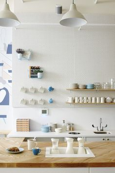 A white pegboard holds baskets and shelves for coffee mugs in Modern Mayberry: One Girl Cookies' Newest Brooklyn Outpost. White Pegboard, Pegboard Storage, Kitchen Storage, Kitchen Pegboard, Ikea Pegboard, Painted Pegboard, Storage Organizers, Storage Baskets, Kitchen Cabinets