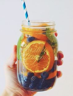 "Orange + Blueberry + Mint + Mason Water (Blueberries pretty much reign as the antioxidant champions clearing free radicals from the body that cause disease and pre mature aging as well as promotes brain health, aka, ""brain food"" duh)"