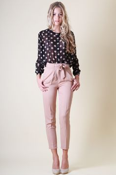 Black polka dot top, light pink capris pants, nude pumps. Cute work look.