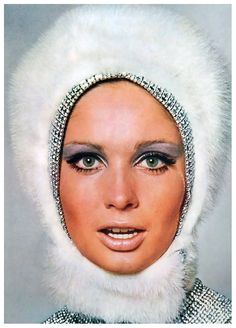 Sue Murray in snow-white mink hood trimmed in rhinestones. For Vogue UK, 1965