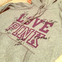 PINK hooded sweatshirt Gray Victoria's Secret PINK hooded sweatshirt with purple writing. Soft, cozy material. Great condition, offers encouraged! PINK Victoria's Secret Tops Sweatshirts & Hoodies