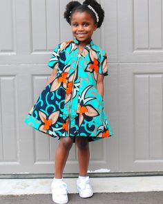Match with your little one in this mommy & me collection. model is and wearing a little girl size m. african print colourful cotton fabric dress fully lined. front zip up. Baby African Clothes, African Dresses For Kids, Latest African Fashion Dresses, African Dresses For Women, African Attire, Little Girl Dresses, Girls Dresses, Kids Dress Wear, Kids Gown