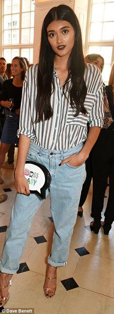 Model material: Neelam Gill allowed her sleek raven locks to cascade down her front...
