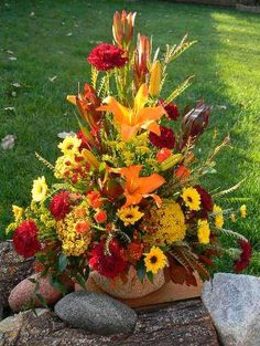 Fall arrangement for the ceremony and reception.  Floral Designs by Jodi